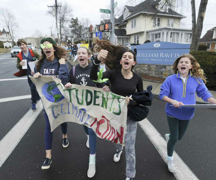 From left, Bridget Brockelman, Tessa Pascarella, Lola Manuel and Field Ogilvy join several hundred students from Greenwich Country Day School as they march to Greenwich Town Hall March 15 to call for action on climate change. Photo: Matthew Brown / Hearst Connecticut Media / Stamford Advocate