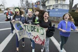 From left, Bridget Brockelman, Tessa Pascarella, Lola Manuel and Field Ogilvy join several hundred students from Greenwich Country Day School as they march to Town Hall on Friday, March 15, 2019 in Greenwich, Conn.,to call for more action on climate change at the local, state and federal level.
