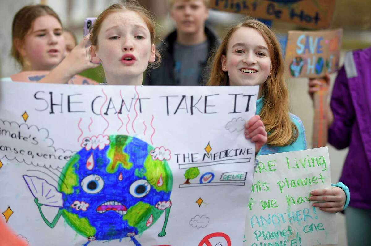 Several hundred students from Greenwich Country Day School march to Greenwich Town Hall on Friday, March 15, 2019 to call for more action on climate change at the local, state and federal level. Now the town, through the Conservation Commission, is looking to do more to educate and inform resident as a two month lecture series begins Wednesday.