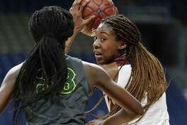 Lady Bulldog forward Maliyah Johnson looks into the lane from high post as Humble Summer Creek plays DeSoto in the semifinals of the girls Class 6A state basketball tournament at the Alamodome on March 1, 2019.