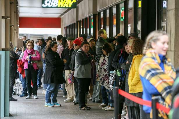 """People wait in line on East Houston for tickets for """"Hamilton,"""" which went on sale Friday morning at the Majestic Theatre box office."""