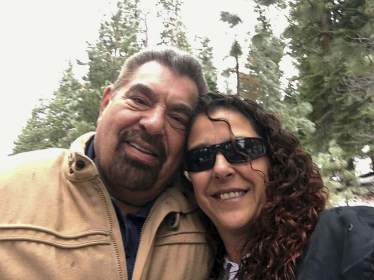 This Dec. 24, 2018, selfie by Julia Ackley shows herself and her father, Antonio Pastini, at Lake Tahoe near Carson City, Nev. Pastini, who had also gone by Jordan Isaacson and was known for years as Ike, was killed while piloting a small plane that crashed into a house in Yorba Linda, Calif., Sunday, Feb. 3, 2019. (Julia Ackley via AP)