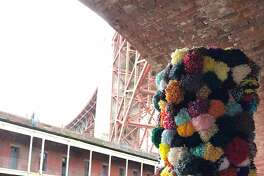 Pompom totem for Immigrant Yarn Project
