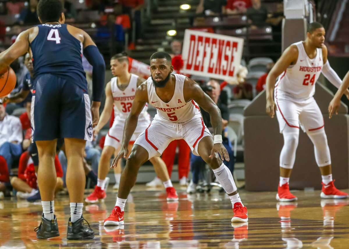 HOUSTON, TX - MARCH 04: Houston Cougars guard Corey Davis Jr. (5) guards Connecticut Huskies guard Jalen Adams (4) during the men's basketball game between the UConn Huskies and Houston Cougars on March 4, 2018 at H&PE Arena in Houston, Texas. (Photo by Leslie Plaza Johnson/Icon Sportswire via Getty Images)