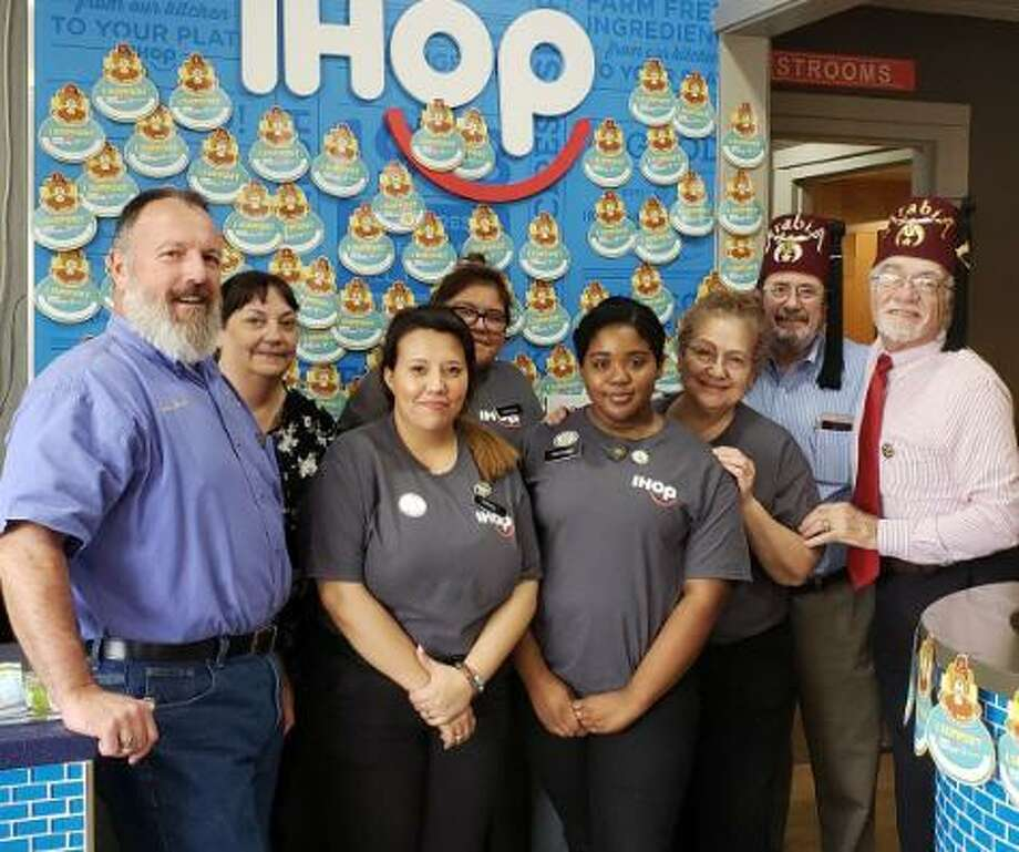 The West Side Shrine Club encouraged people to participate in IHOP National Pancake Day on March 12 to raise money for the Shriner Hospital for Children at the I-HOP Restaurant at19989 Katy Freeway at Fry Road.Led by Jeff Buchanan, club members encouraged customers to support the 22 free Shriner Hospitals while I-HOP donated free pancake stacks from 7 a.m.-7 p.m. Club members from left are Keith Borst, Buchanan and David Frishman. Photo: West Side Shrine Club / West Side Shrine Club