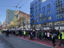 Students walked out of class on Friday, March 15, 2019 to participate in a nationwide coordinated protest against what they perceive as a lack of action on the part of politicians to address climate change. The students were photographed as they marched along Market Street with an ultimate destination of Nancy Pelosi's San Francisco field office.