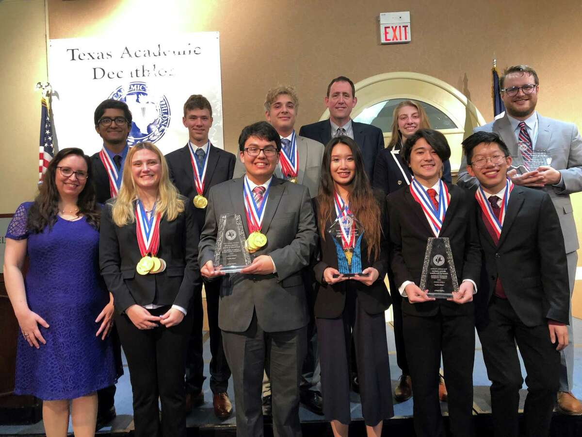 At the Sunday awards ceremony for the Texas Academic Decathlon is the Dulles High School Academic Decathlon team, from left in front, are Kelsey Halfen, coach; Olivia Jackson; Simon Sanchez-Paiva; Sophie Yangyi; Logan House and Robert Yang; and in back are Davis Varghese; Ethan Sollenberger; Ali Abi Nassif; Mark Rosenbalm, assistant coach; Lana Haffar; and Andrew Hartman, coach. This month the team won its third consecutive 6A state title.