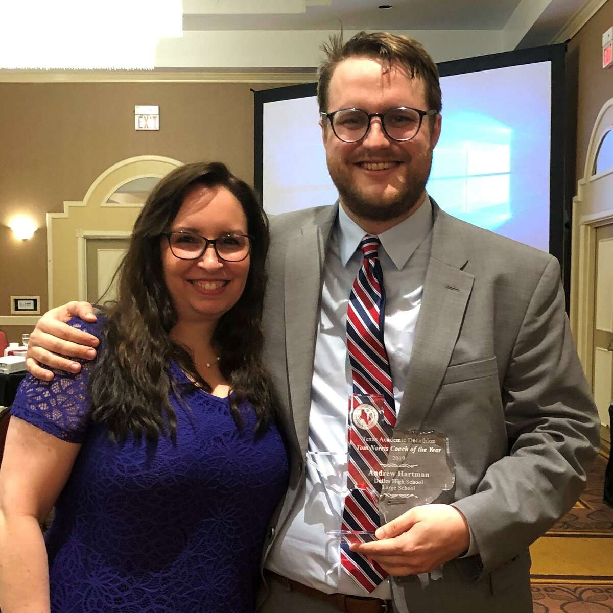 Andrew Hartman, in his fifth year as coach of the Dulles High School Academic Decathlon team, received the 2019 Tom Norris Texas Academic Decathlon Coach of the Year for a large school. He was nominated by Dulles High School Academic Decathlon coach Kelsey Halfen, left.