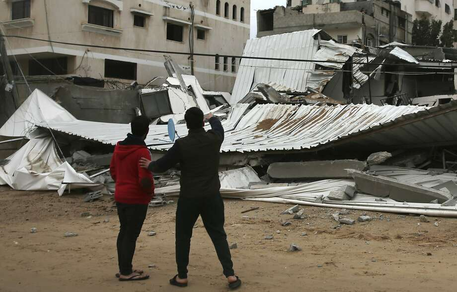 Palestinians inspect the damage to the Hamas ministry of prisoners after the building was destroyed by Israeli warplanes in Gaza City. Photo: Adel Hana / Associated Press