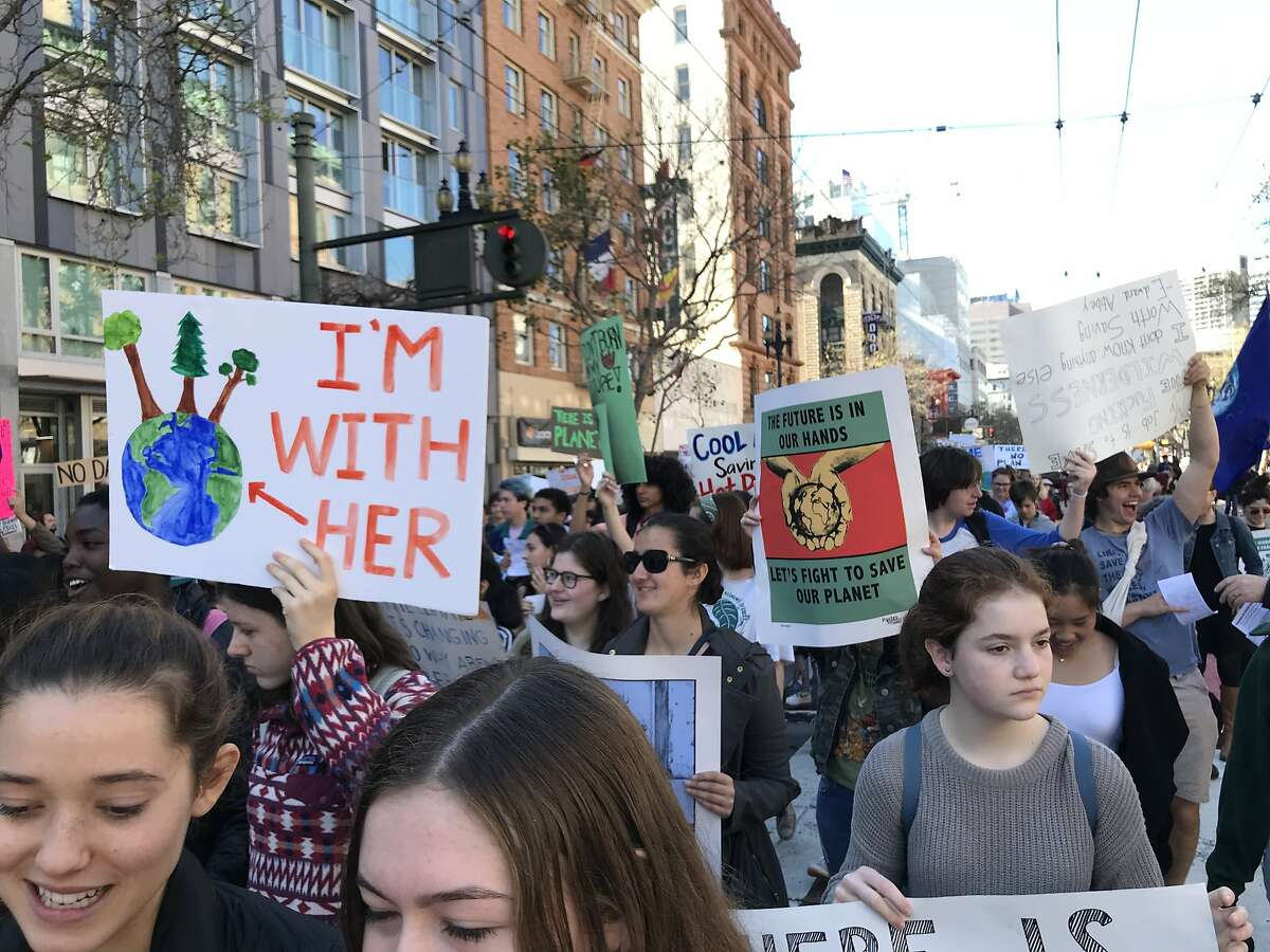 Several thousand students walked out of Bay Area classrooms Friday to emphasize the dire consequences of climate change and criticize adults' inaction.