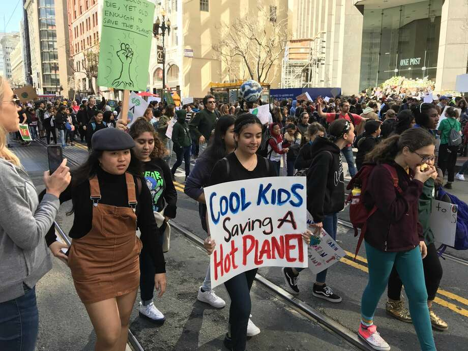 Students walked out of class on Friday, March 15, 2019 to participate in a nationwide coordinated protest against what they perceive as a lack of action on the part of politicians to address climate change. The students were photographed as they marched along Market Street with an ultimate destination of Nancy Pelosi's San Francisco field office. Photo: Brandon Mercer / SFGATE
