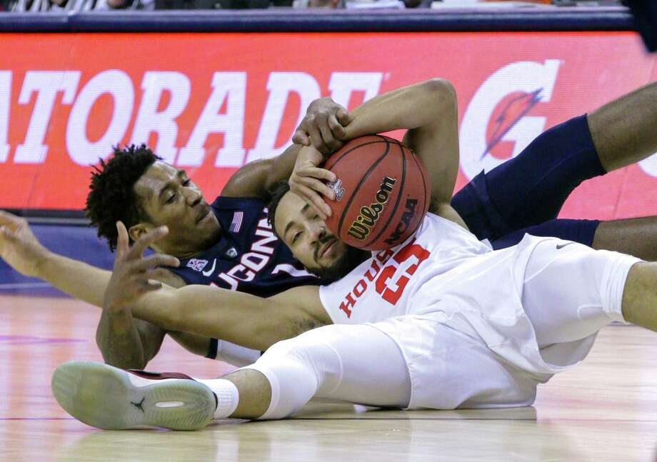 Connecticut guard Christian Vital and Houston's Galen Robinson Jr. scramble for a loose ball during the first half of an NCAA college basketball game at the American Athletic Conference tournament Friday, March 15, 2019, in Memphis, Tenn. (AP Photo/Troy Glasgow) Photo: Troy Glasgow, Associated Press / Copyright 2019 The Associated Press. All rights reserved