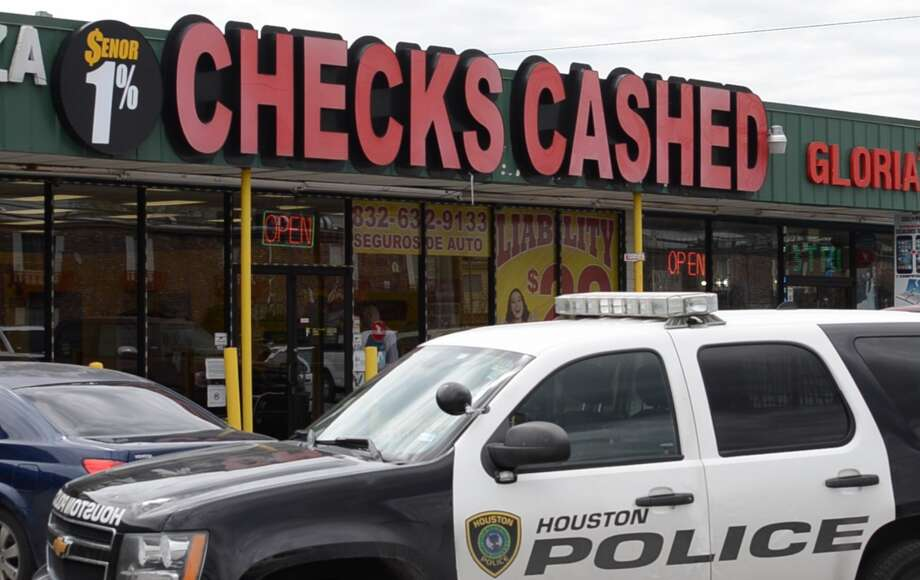 Police are searching for a pair of suspects accused of robbing a an armored truck employee in southwest Houston on Friday, March 15, 2019. Photo: Jay R. Jordan