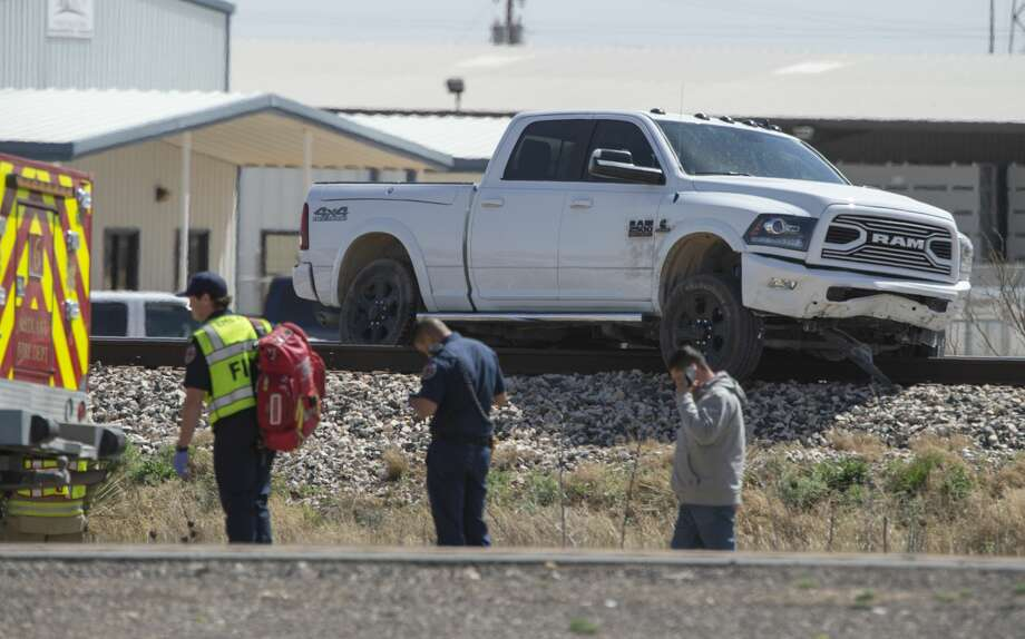Midland emergency responders check on a one vehicle accident 03/15/2019 afternoon that left a pickup truck stuck on the train tracks. No one was reported injured in the accident along Business 20, just west of Loop 250, and the truck was removed from the tracks before a train passed through the area. Tim Fischer/Reporter-Telegram Photo: Tim Fischer