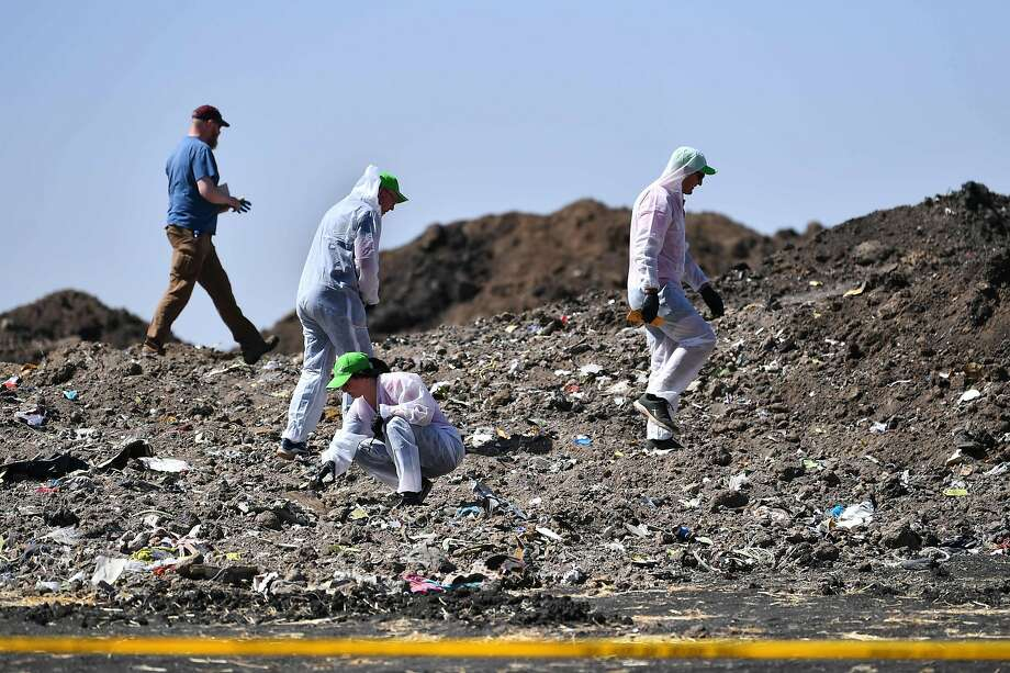 Forensic experts work at the crash site of an Ethiopian Airlines jet that killed 157 people near the town of Bishoftu. Photo: TONY KARUMBA;Tony Karumba / AFP / Getty Images