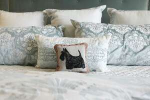 The Megas have always had Scottish Terriers, so a little accent pillow on their bed is a nice touch. Newly designed home of Jeanne and Jeff Mega by designer is Lynne T. Jones on Friday, March 8, 2019 in Sugar Land.