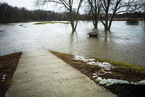 The Tittabawassee River rises above flood stage on Friday, March 15, 2019 in Midland. (Katy Kildee/kkildee@mdn.net)