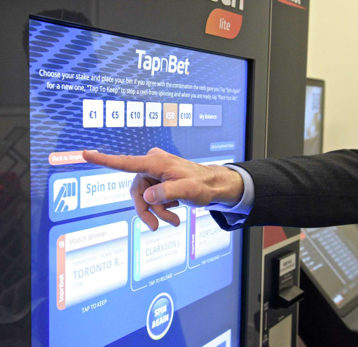 The president of a sports betting technology firm gives a presentation on a interactive betting terminal at a Connecticut Lottery-hosted interactive educational forum in 2019. The forum was to demonstrate some of the products that are available in the marketplace for online and mobile lottery and sports betting.