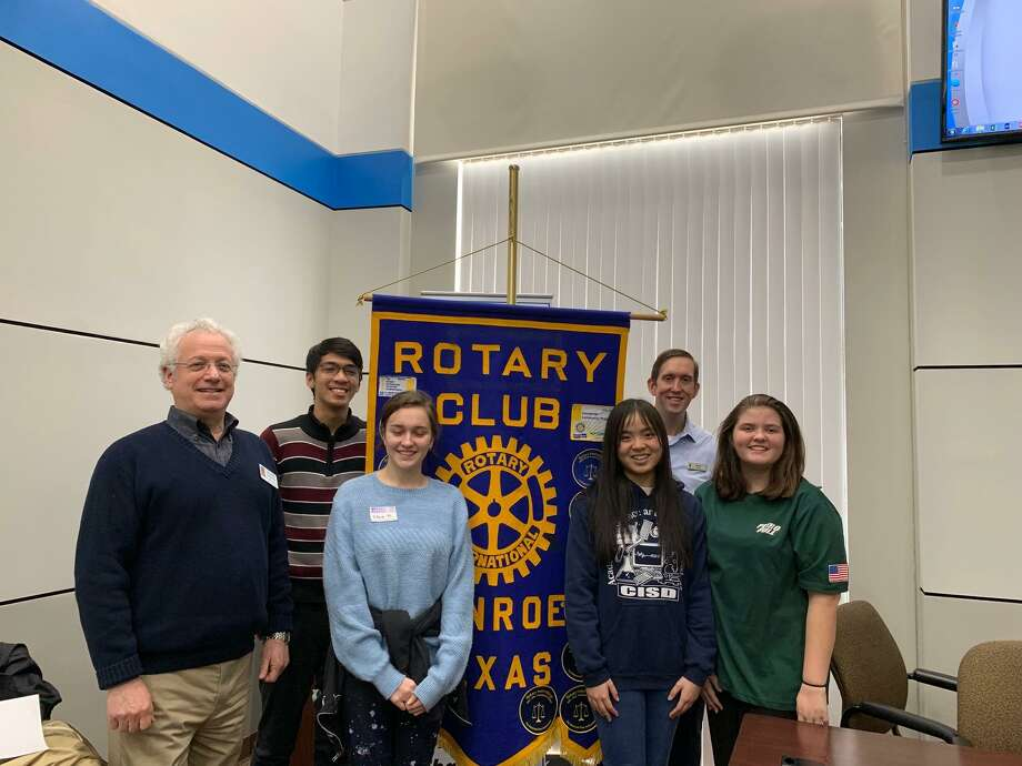 Rotary Club of Conroe President Leland Dushkin and Past President Nick Davis gathered with Conroe High School Students Courtney Stoutes, Melanie Nguyen, Aeronn Sarmiento and Elena Nikolaychuk at the RCC meeting last week. The CHS Students all attended RYLA - Rotary Youth Leadership Awards - in January, sponsored by RCC. Photo: Courtesy Photo