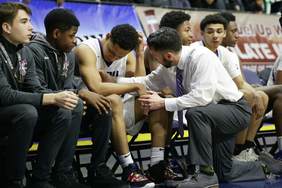 Troy's Nazaire Merritt, is consoled after Friday's Class A semi-final loss to Mendon at the boy's basketball state championships in Binghamton. Photo: Erin Reid Coker