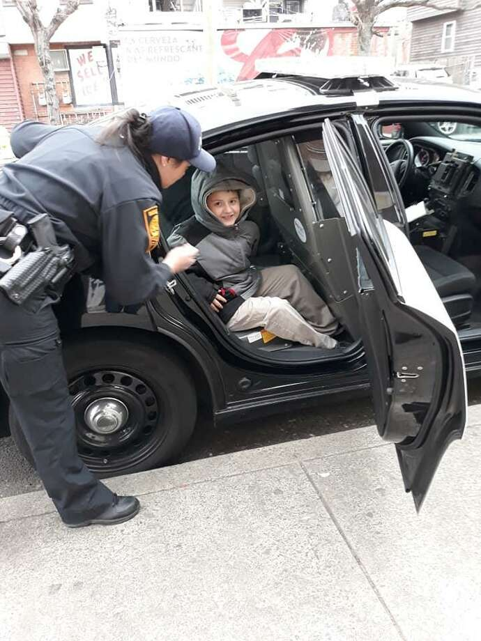 Bridgeport police officers visited Minerva Ramos' son Joziah on Monday before he had surgery. Photo: CONTRIBUTED PHOTO
