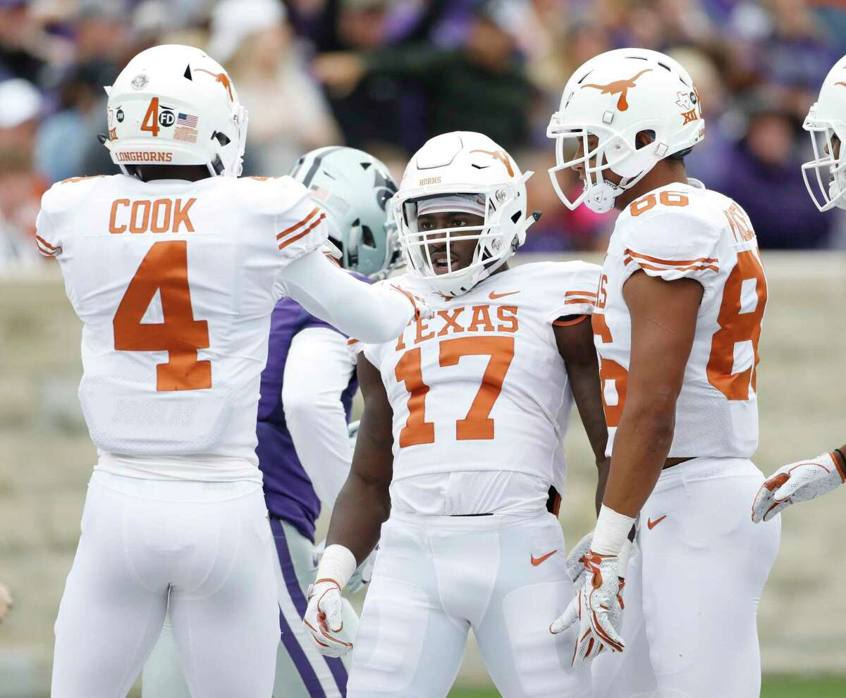 Texas kick returner D'Shawn Jamison (17) celebrates with Anthony Cook (4) and Jordan Pouncey (86) after returning a Kansas State punt for a touchdown during the first quarter of a college football game in Manhattan, Kan., Saturday, Sept. 29, 2018. (AP Photo/Colin E. Braley)