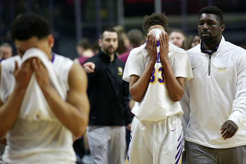 Troy's Zaveon Little, 33, walks back to the bench after Friday's Class A semi-final loss to Mendon at the boy's basketball state championships in Binghamton.