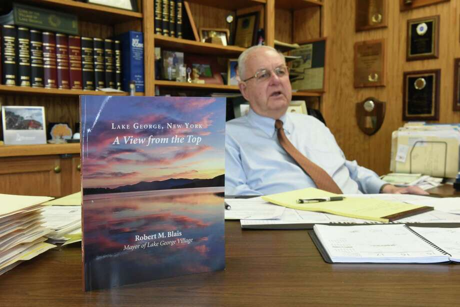 "Lake George Village Mayor Bob Blais wrote a book about his experiences, ""Lake George: A View from the Top,"" on Wednesday, March 13, 2019, at his office in Lake George, N.Y. He is the state's longest tenured mayor. (Will Waldron/Times Union) Photo: Will Waldron, Albany Times Union / 40046417A"