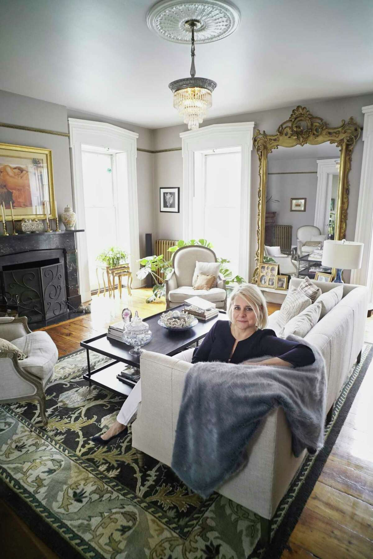 Stephanie Pettit poses for a photo in the living room at her home on Tuesday, March 12, 2019, in Troy, N.Y. (Paul Buckowski/Times Union)