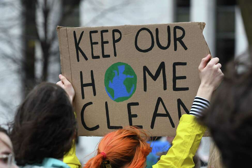 Albany High School ninth-grader, Aeonna Marsico takes part in a global protest on climate change on Friday, March 15, 2019, at West Capitol Park in Albany, N.Y. Students worldwide walked out of school to join in protests inspired by Greta Thunberg, a Swedish teen who gained international attention for raising awareness about climate change. She is a Nobel Peace Prize nominee. (Will Waldron/Times Union)