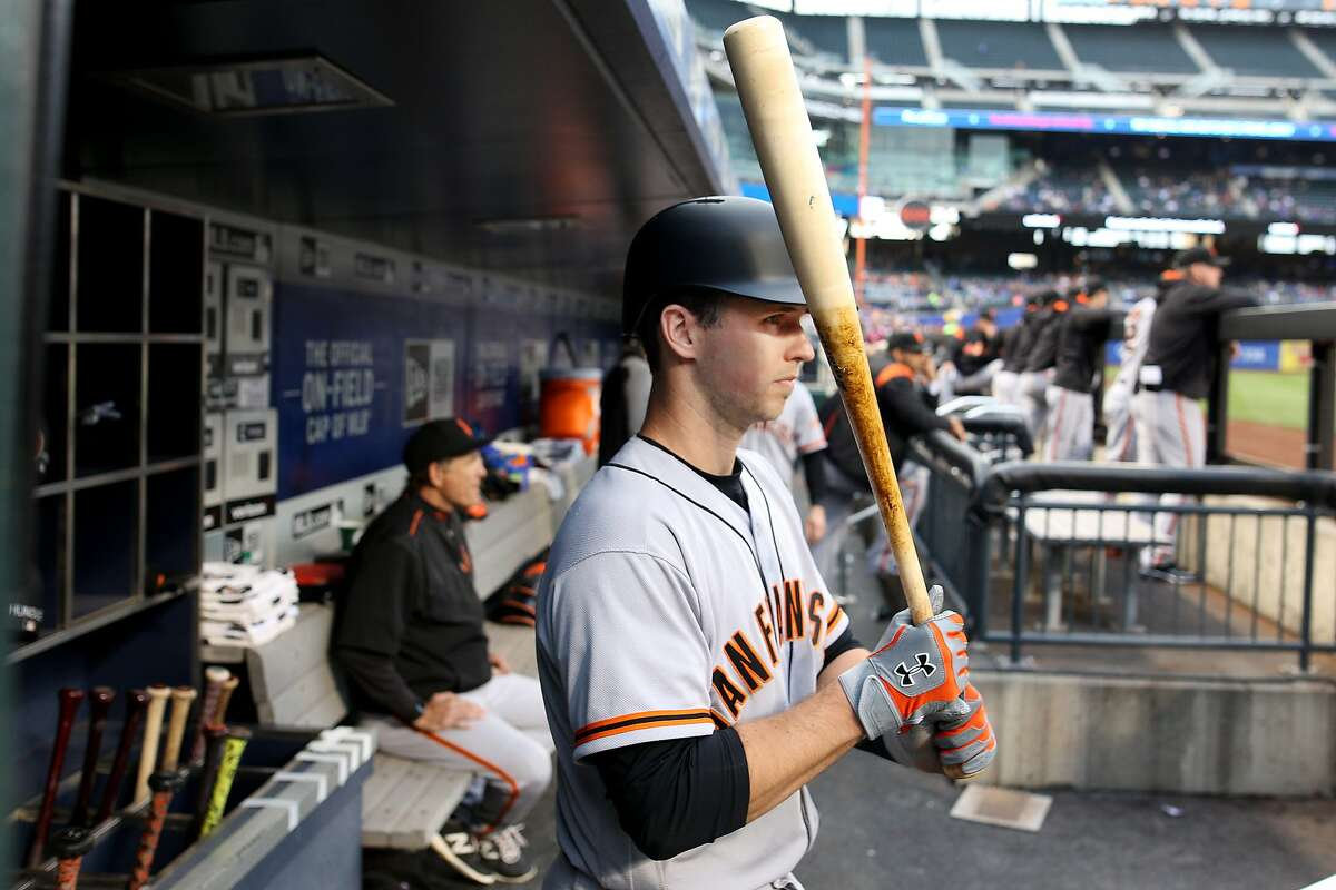 NEW YORK, NEW YORK - May 9: Buster Posey #28 of the San Francisco Giants in the dugout preparing to bat during the San Francisco Giants Vs New York Mets regular season MLB game at Citi Field on May 09, 2017 in New York City. (Photo by Tim Clayton/Corbis via Getty Images)