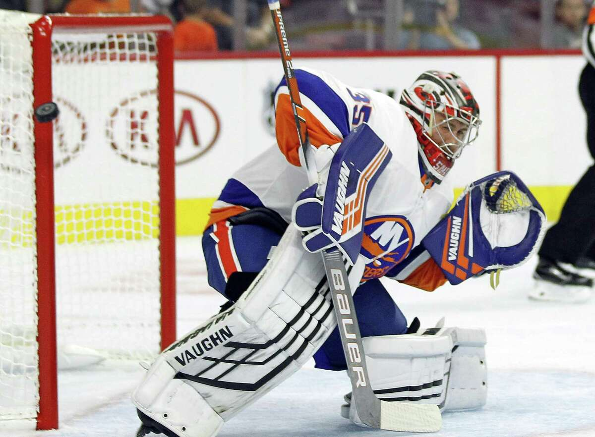 The New York Islanders' Jeremy Smith leans away from the net as the puck passes by the pipe during a preseason game against the Philadelphia Flyers on Sept, 17 in Philadelphia.