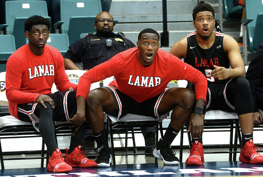 From left, Lamar's Jordan Hunter, Christian Barrett and Avery Sullivan anxiously watch as the Cardinals put up a basket whilebehind by two points with seconds to go as they battle University of New Orleans during their Southland tournament match-up Thursday at the Merrell Center in Katy. Photo taken Thursday, March 14, 2019 Kim Brent/The Enterprise Photo: Kim Brent/The Enterprise