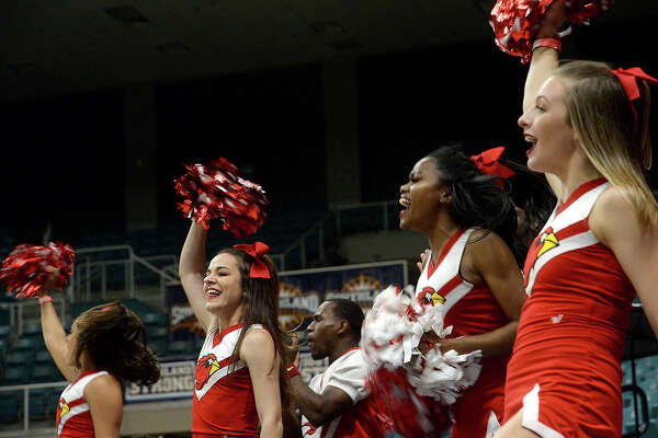Lamar's cheerleaders root on the Cardinals as they face Houston Baptist during their Southland tournament match-up Wednesday at the Merrell Center in Katy. Photo taken Wednesday, March 13, 2019 Kim Brent/The Enterprise