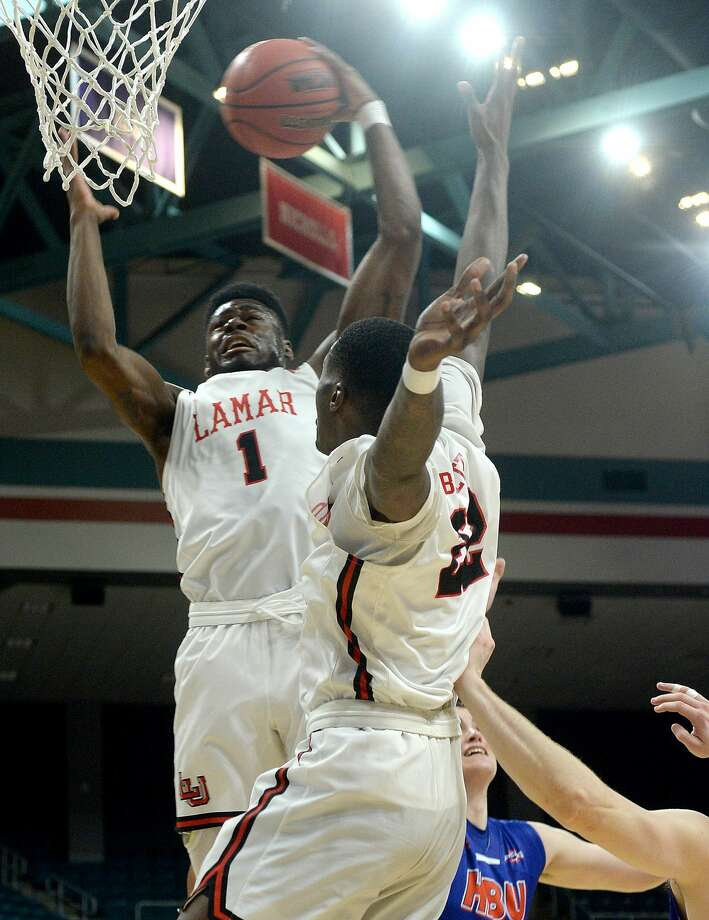 Lamar's Michael Kolawole and Christian Barrett secure the rebound against Houston Baptist during their Southland tournament match-up Wednesday at the Merrell Center in Katy. Photo taken Wednesday, March 13, 2019 Kim Brent/The Enterprise Photo: Kim Brent/The Enterprise