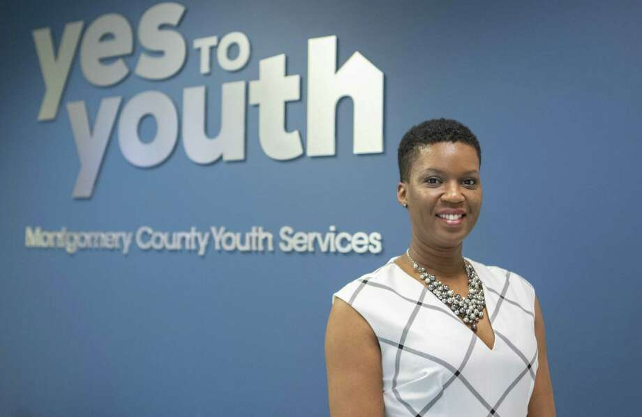 LaToya Carter stands near the entrance to Yes to Youth - Montgomery County Youth Services where she recently accepted a human resources position Wednesday, March 13, 2019 in The Woodlands. Photo: Cody Bahn, Houston Chronicle / Staff Photographer / © 2018 Houston Chronicle