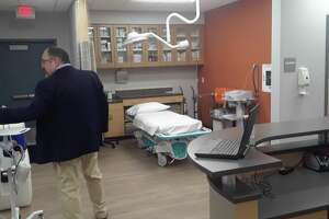 American Family Care Urgent Care owner Tom Kelly leads a tour of the new facility in Torrington.