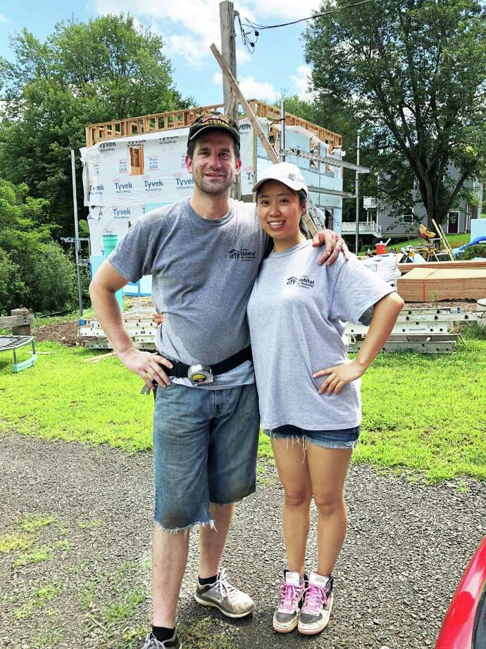 Middlesex Habitat for Humanity recently received a $5,000 grant from the Community Foundation of Middlesex County. Combat veteran Dustin Fitzpatrick and his wife Yiran, the latest recipients of a new home, put a lot of sweat equity into its construction. Photo: Contributed Photo
