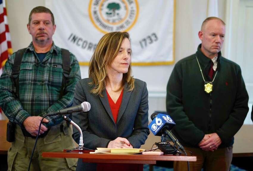 District Attorney Andrea Harrington, center, speaks during a news conference Wednesday, March 13, 2019, at Sheffield Town Hall about a house fire on Home Road that took the lives of five people in Sheffield, Mass. Behind Harrington are Sheffield Fire Chief Brent Getchell, left, and Massachusetts State Police Lt. Detective Ed Culver.