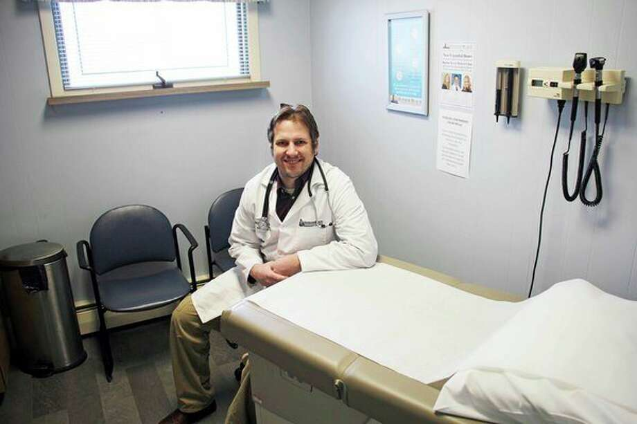 Dr. Nicklaus Bradley enjoys getting to know his patients, both young and old. (Seth Stapleton/Huron Daily Tribune)