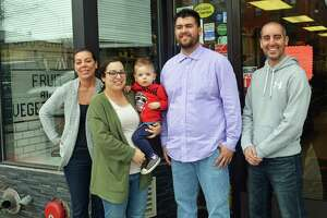 Josh Morris, second from right, is the new owner of Public Market, which has been at 480 Main St., Middletown, since 1915. Shown, from left are Maria Passacantando, Amelia Passacantando, Giovanni Passacantando, Morris and Middletown Police Officer John Passacantando. Morris purchased the shop Friday and will reopen its doors Monday morning.