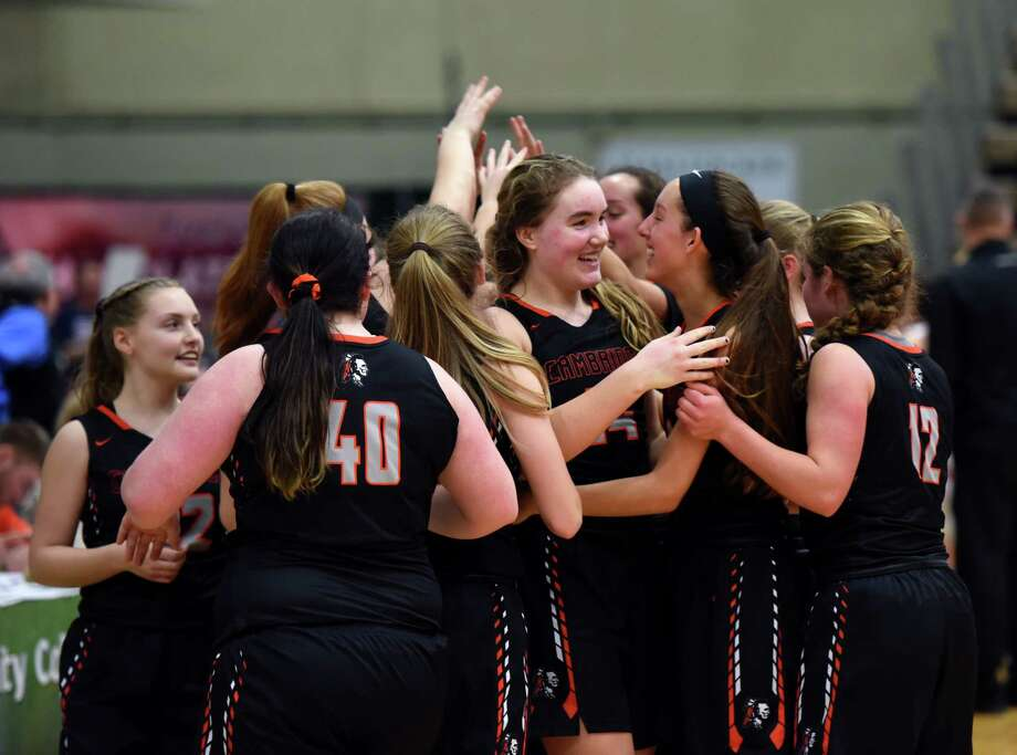Cambridge players celebrate their win over Maple Grove on Friday, March 15, 2019 at the McDonough Sports Complex in Troy, NY. (Phoebe Sheehan/Times Union) Photo: Phoebe Sheehan, Albany Times Union / 40046438A