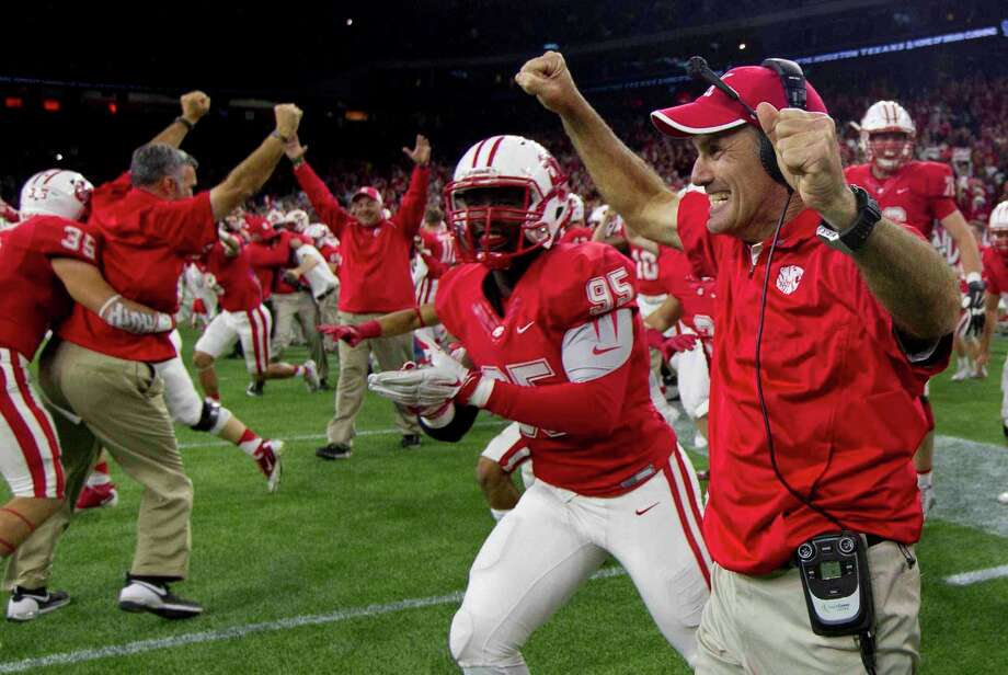 Katy head coach Gary Joseph and senior JaQuon Goethe celebrate after defeating Austin Lake Travis 34-7 to win the Class 6A Division II state championship Dec. 19at NRG Stadium in Houston. The win, Katy's eighth, tied the Tigers with Celina and Southlake Carroll for the most state championships. Photo: Jason Fochtman / Internal