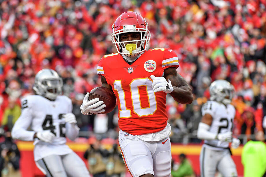 Kansas City Chiefs wide receiver Tyreek Hill trots into the end zone to score against the Oakland Raiders on Dec. 30, 2018 at Arrowhead Stadium in Kansas City, Mo. Hill is under investigation for an alleged battery incident. Photo: John Sleezer, TNS / Kansas City Star