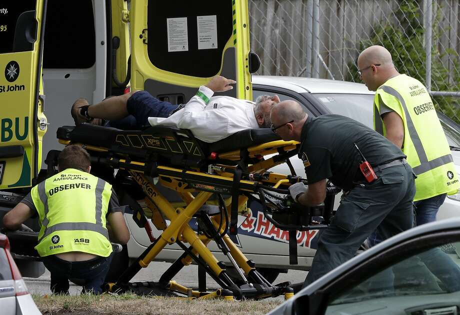 "Ambulance staff take a man from outside a mosque in central Christchurch, New Zealand, Friday, March 15, 2019.  Multiple people were killed in mass shootings at two mosques full of worshippers attending Friday prayers on what the prime minister called ""one of New Zealand's darkest days,"" as authorities detained four people and defused explosive devices in what appeared to be a carefully planned attack.  Photo: Mark Baker, Associated Press"