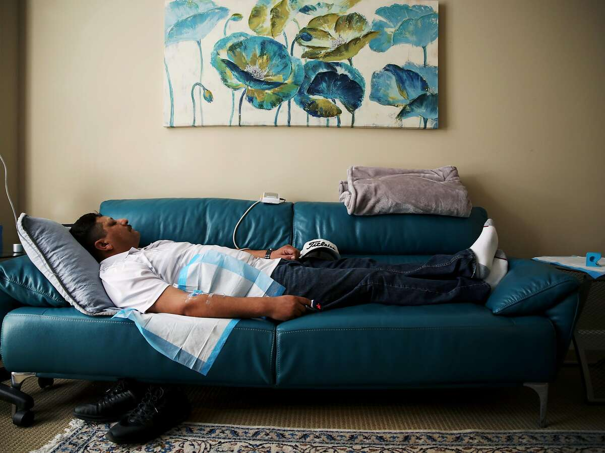 """Dr. M. Rameen """"Dr. G"""" Ghorieshi treats patient Ernie Ruiz while he sleeps during a visit to Palo Alto Mind Body in Palo Alto, Calif., on Wednesday, March 13, 2019. Ghorieshi gave his patient a ketamine IV at the clinic. A new ketamine-based nasal spray treatment was approved by the FDA last week to treat severe depression."""
