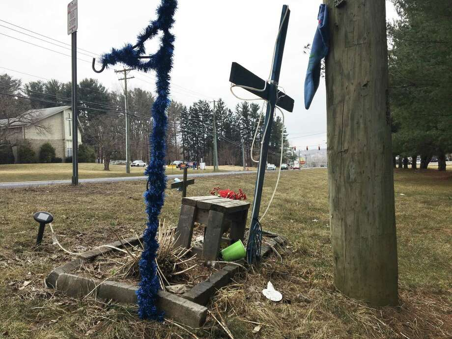 A cross is erected in memory of a pedestrian who was fatally struck while crossing Route 7 in New Milford by Picket District Road. Another man was killed not far from this cross while crossing the road on March 14, 2019. Photo: Katrina Koerting / Reporter / The News-Times