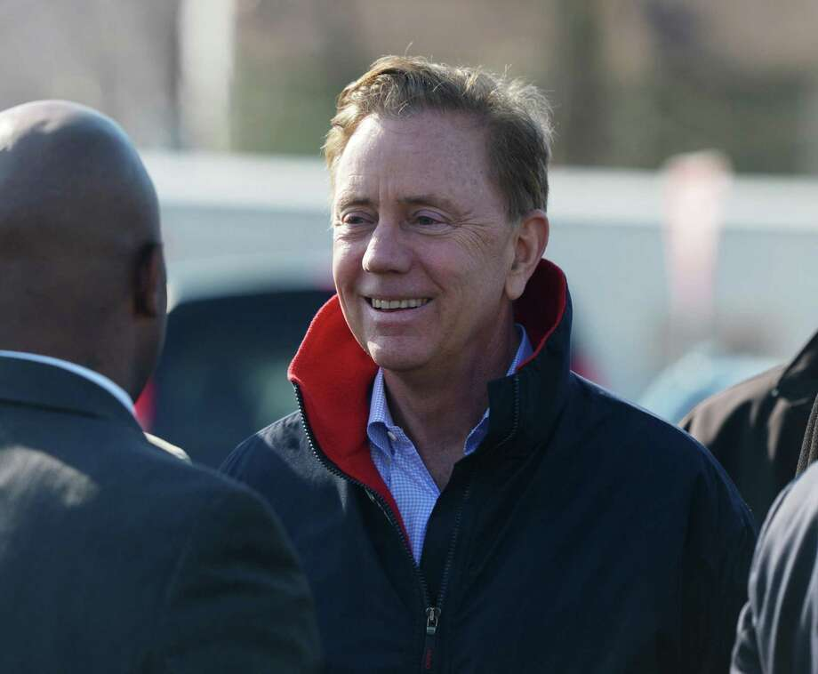Connecticut Gov. Ned Lamont chats before publicly speaking about the new overpass being built spanning I-95's Exit 9 in Stamford, Conn. Monday, March 11, 2019. Connecticut Gov. Ned Lamont joined Stamford Mayor David Martin to talk about the replacement of the bridge that spans across I-95 at East Main Street and the importance of investing in the state's infrastructure. Photo: Tyler Sizemore / Hearst Connecticut Media / Greenwich Time
