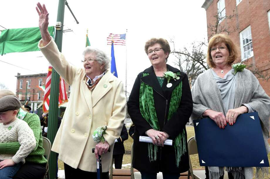 From left, Joan D. Connor waves to the crowd standing next to her daughters, Joanne Connor and Tricia Connor Thompson, during the 28th Annual St. Patrick's Day Celebration where Joan D. Connor was named the West Haven Irish Person of the Year in front of City Hall in West Haven on March 15, 2019. Photo: Arnold Gold / Hearst Connecticut Media / New Haven Register