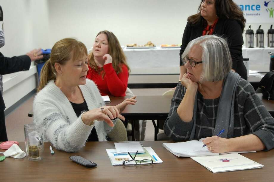 Fran Chappel, Director of Canaan Childcare Center and Judy Courtot, EdAdvance Early Childhood Consultant collaborate on priority issues during the early childhood care roundtable event at EdAdvance. Photo: Contributed Photo